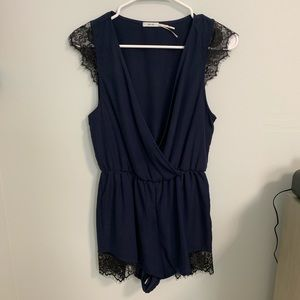 Kimchi Blue navy romper with black lace detail